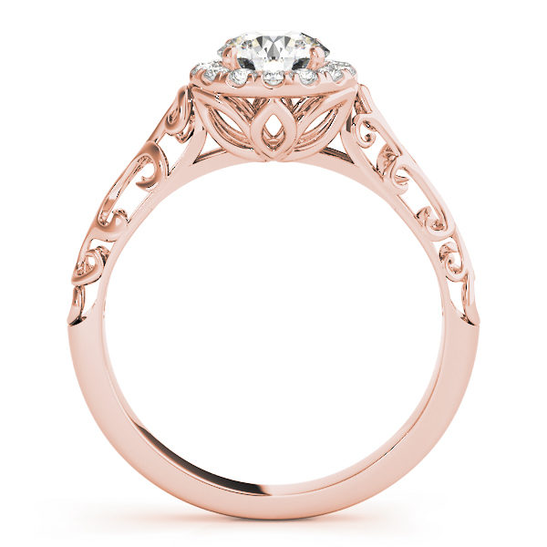 Rose gold engagement ring with a filigree design band, pave halo style centre piece and a petal under gallery standing upright