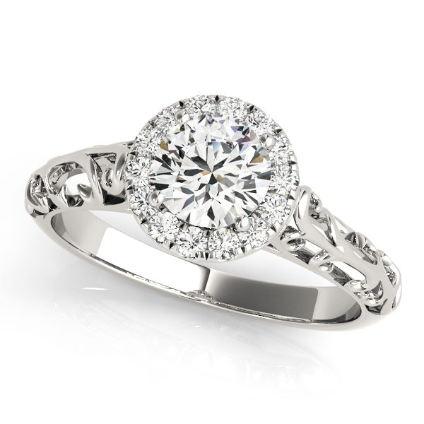 White gold engagement ring with a filigree design band and a pave halo style centre piece