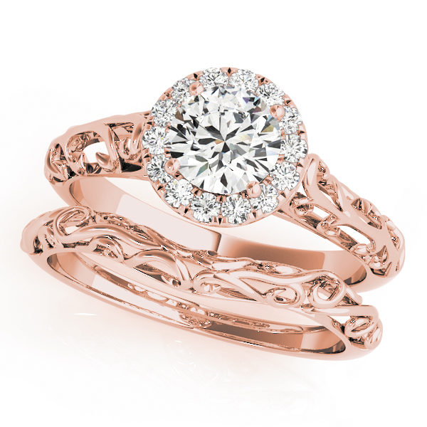 Wedding set made of rose gold with two rings an engagement ring with halo and filigree design and a curved filigree wedding band