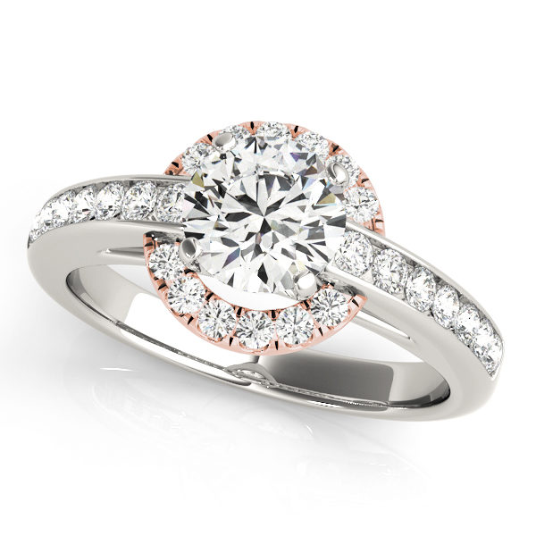 White gold engagement ring with a chanel set band and a halo style centre piece with set on a rose gold