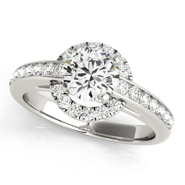 White gold engagement ring with a chanel set band and a halo style centre piece with set on a yellow gold
