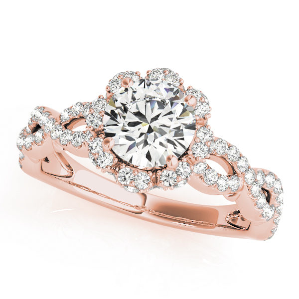 Rose gold engagement with an openwork band and a flower style halo diamond centre piece