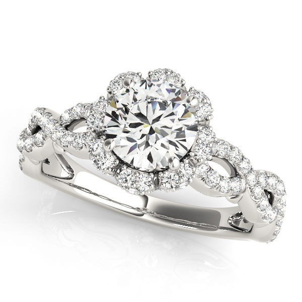 White gold engagement with an openwork band and a flower style halo diamond centre piece