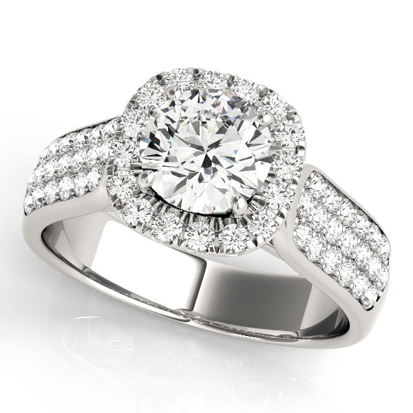 White gold thick band engagement ring with three rows of smaller diamonds on each side of the band