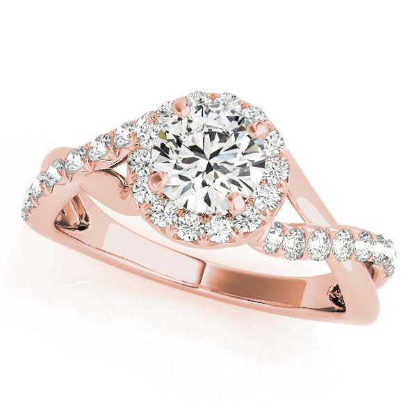 Rose gold twisted engagement ring with round cut diamond as center stone