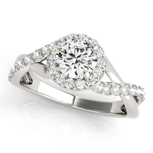 White gold twisted engagement ring with round cut diamond as center stone
