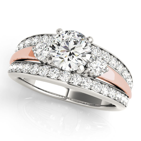 Two tone engagement ring consist of white gold and rose gold in the middle of split shank