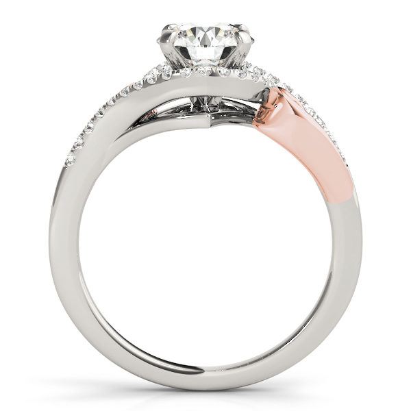 A side view of a white and rose gold engagement ring with round centre cut jewel and diamonds engraved in the band