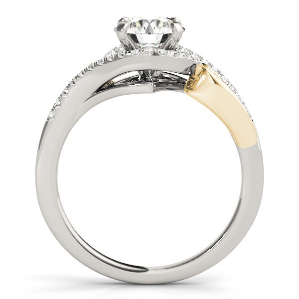 A side view of a white and yellow gold engagement ring with round centre cut jewel and diamonds engraved in the band