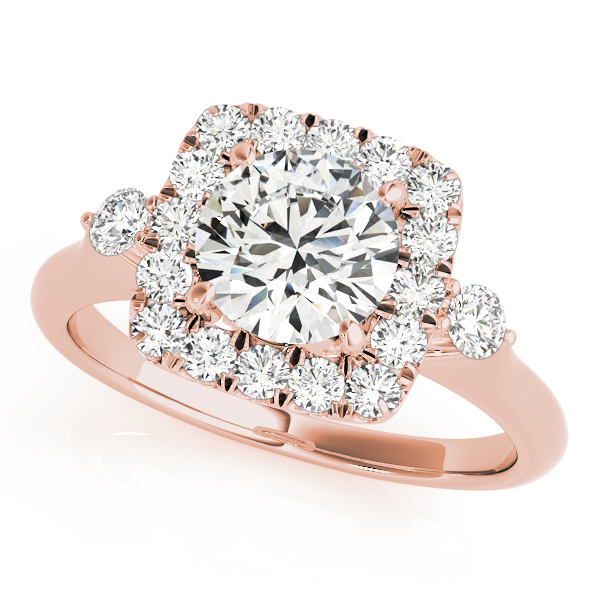 A front view of rose gold engagement ring with a round centre cut jewel and halo of diamonds on the side and shoulders.