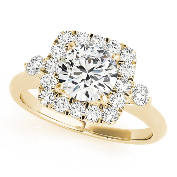A front view of yellow gold engagement ring with a round centre cut jewel and halo of diamonds on the side and shoulders.