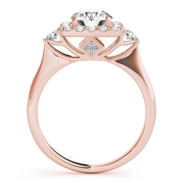 A side view of rose gold engagement ring with a round centre cut jewel and halo of diamonds on the side and shoulders.