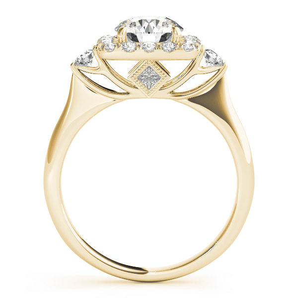 A side view of yellow gold engagement ring with a round centre cut jewel and halo of diamonds on the side and shoulders.