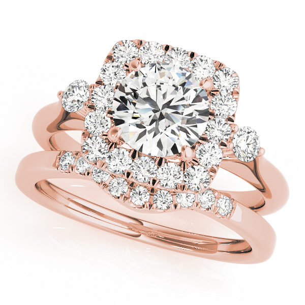 A side view of rose gold wedding set with a centre cut jewel and halo of diamonds on the side and shoulders.