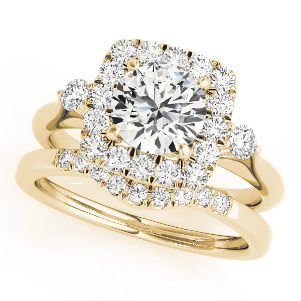 A side view of yellow gold wedding set with a centre cut jewel and halo of diamonds on the side and shoulders.