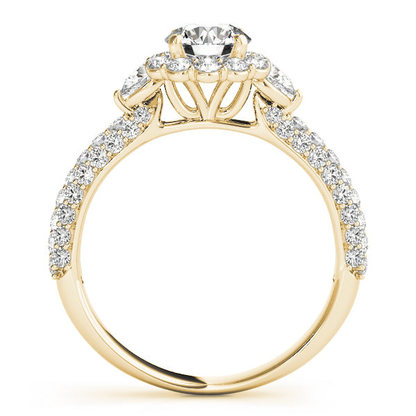 A side view of a yellow gold, pave set band engagement ring with a flower style diamond halo ring, with petal under gallery.