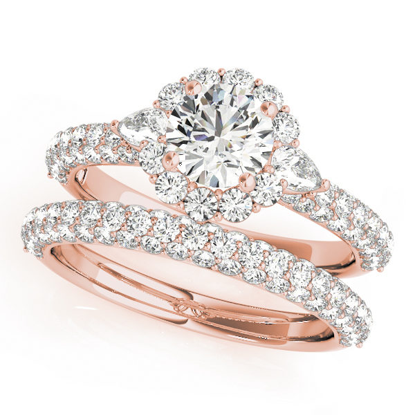A horizontal view of a rose gold diamond engagement ring, with a round cut centre jewel surrounded by a halo of diamonds on the side and a double diamond band.