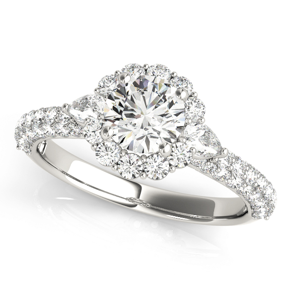 A side view of a white gold, pave set band engagement ring with a flower style diamond halo ring, with petal under gallery.