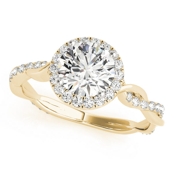 A diamond four prong halo engagement ring with a twisted style yellow gold band, one of the twists embellished with surface prong set diamonds.