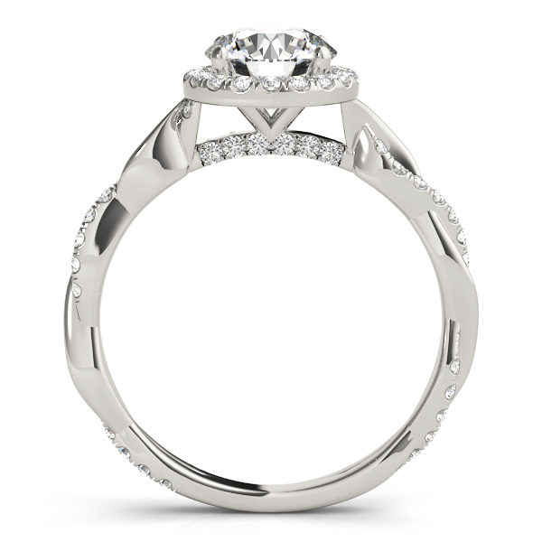 A side view of a white gold halo engagement ring, the band is made up of two twisted metal, one has bezel set diamonds in it while the other is plain.