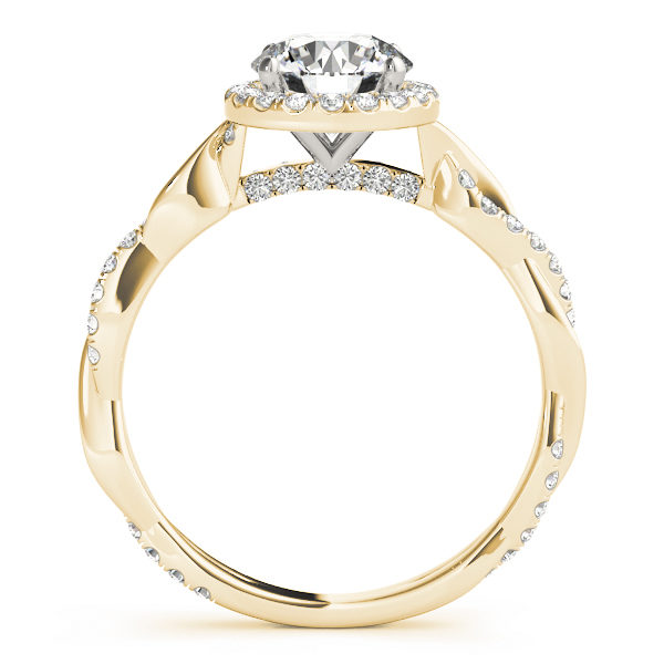 A side view of a yellow and white gold halo engagement ring, the band is made up of two twisted metal, one has bezel set diamonds in it while the other is plain.