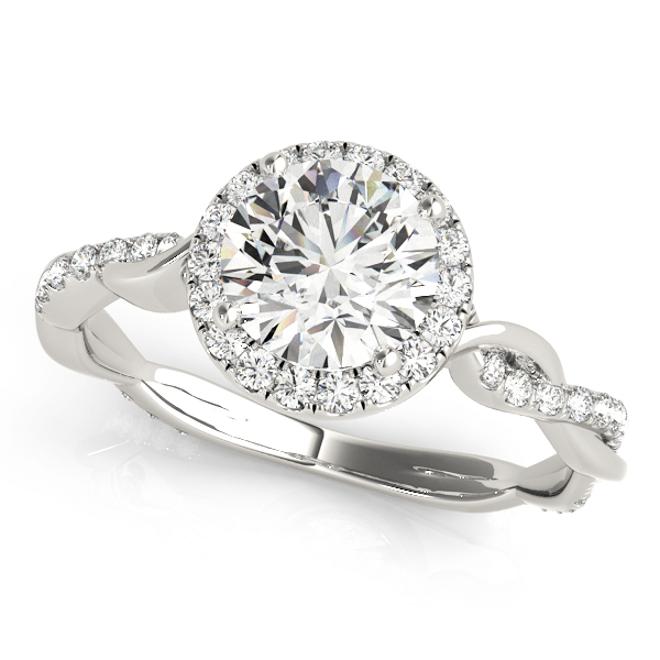 A diamond four prong halo engagement ring with a twisted style white gold band, one of the twists embellished with surface prong set diamonds.
