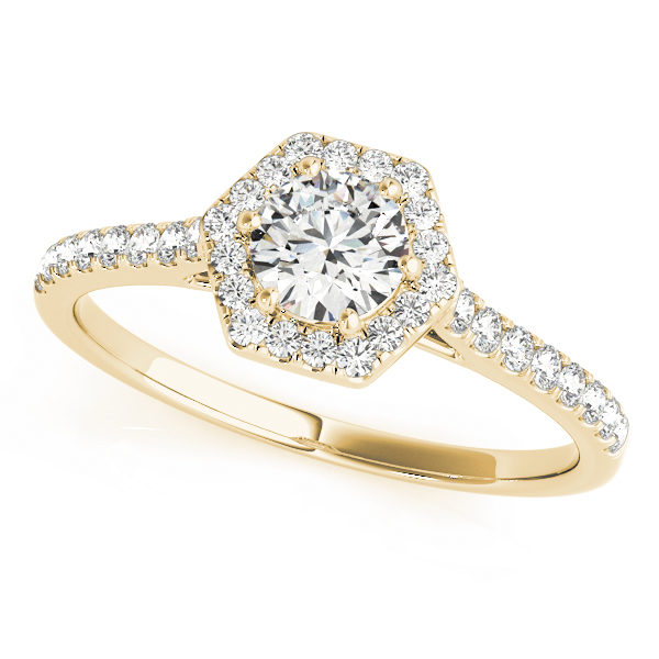 A yellow gold diamond engagement ring, with a halo 6 prong diamond set head, and a scallop style band.