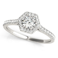 A white gold diamond engagement ring, with a halo 6 prong diamond set head, and a scallop style band.