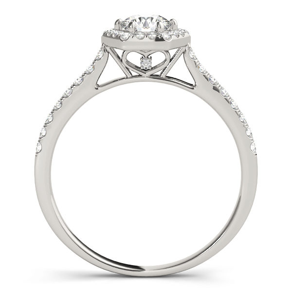 Side view of a six prong diamond halo white gold engagement ring, with bezel set diamonds embedded into its side bands, plus a heart shaped under gallery design.