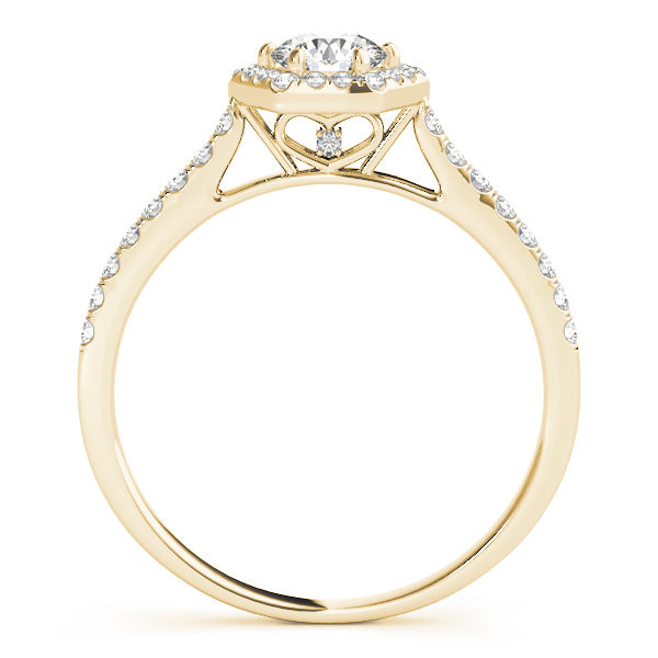 Side view of a six prong diamond halo yellow gold engagement ring, with bezel set diamonds embedded into its side bands, plus a heart shaped under gallery design.