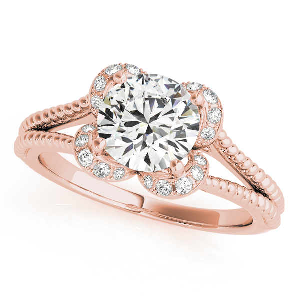 Top view of a rose gold split shank halo engagement ring in a rope design band