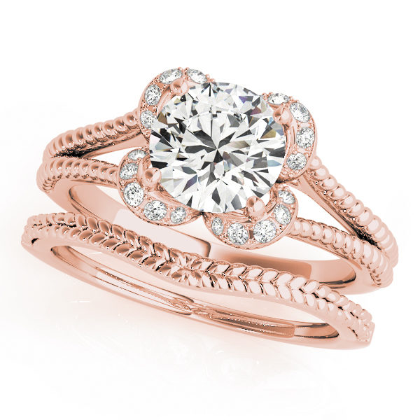 Rose gold split shank halo engagement ring in a rope design band and a rope wedding band