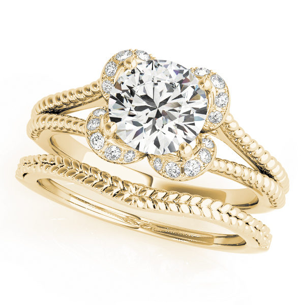 Yellow gold split shank halo engagement ring in a rope design band and a rope wedding band