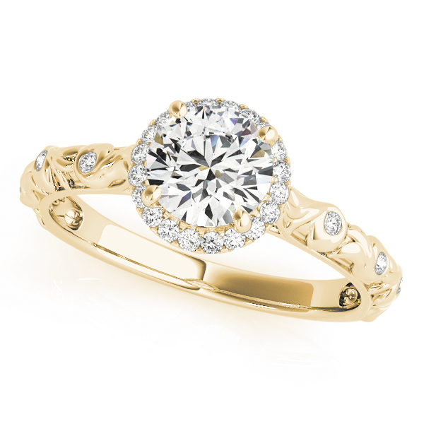top view of a single center stone halo engagement ring with swirl design shank in yellow gold