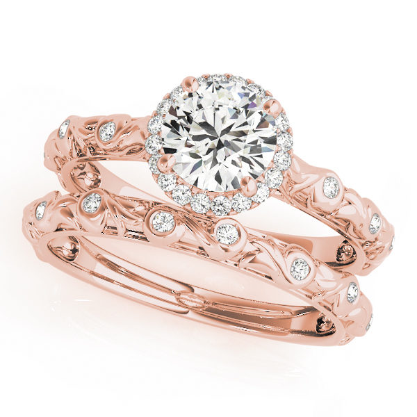 top view of a single center stone halo engagement ring with swirl design shank and a swirl wedding band in rose gold