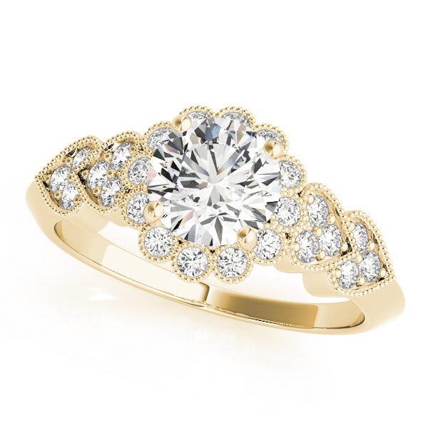 top view of a hearts round halo engagament ring in yellow gold