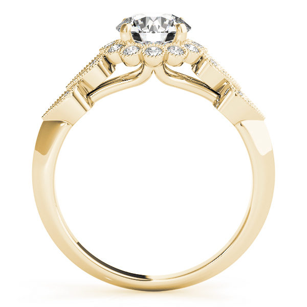 front view of a hearts round halo engagament ring in yellow gold