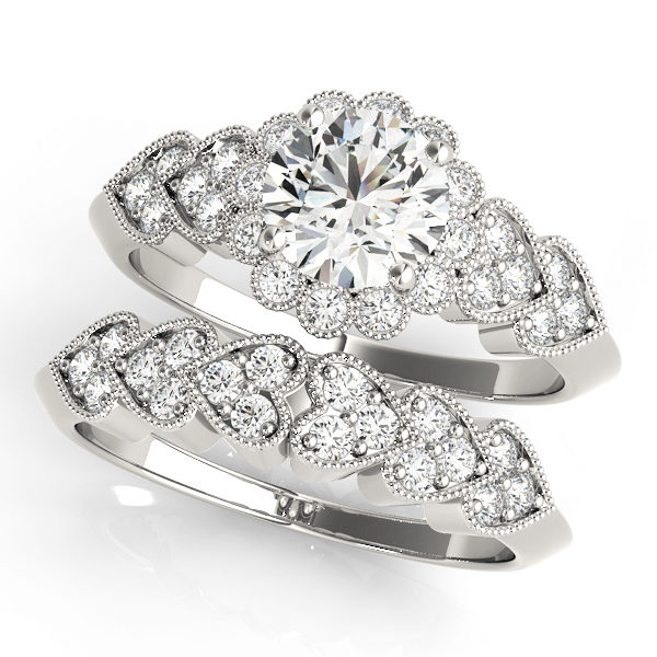 top view of a hearts round halo engagament ring and a heart wedding band in white gold