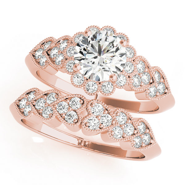 top view of a hearts round halo engagament ring and a heart wedding band in rose gold