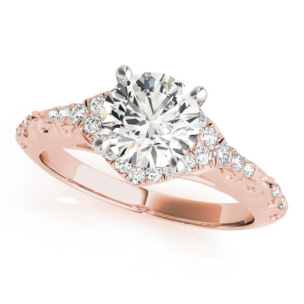 A diamond engagement ring with a centre piece held in place by four white gold prongs, and a halo design surrounding it, with an engraved filigree rose gold band.