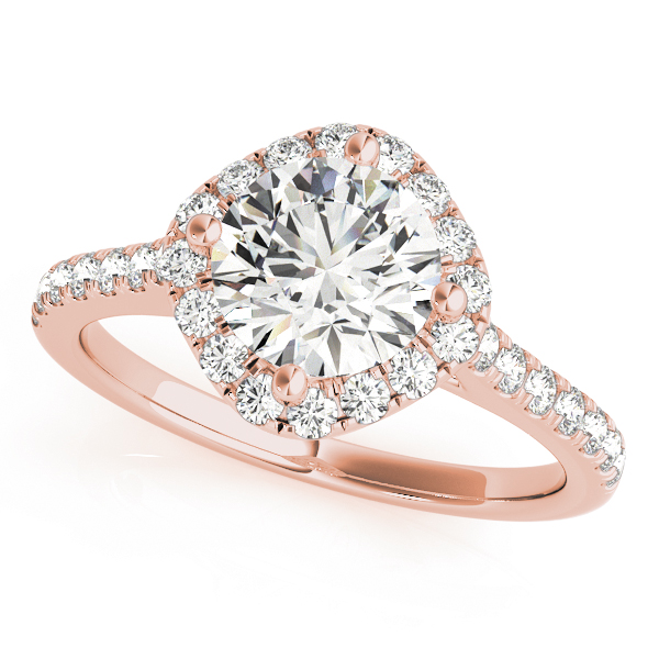 A rose gold engagement ring with a diamond shaped head, set in diamond halo design, and a diamond embellished band.