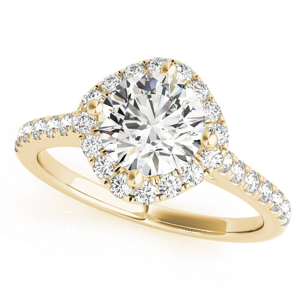 A yellow gold engagement ring with a diamond shaped head, set in diamond halo design, and a diamond embellished band.