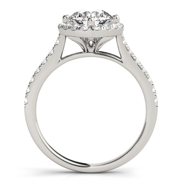 The side view of a white gold engagement ring, with a diamond halo centre piece, a flower shaped under gallery, and a diamond embellished band.