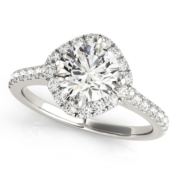 A white gold engagement ring with a diamond shaped head, set in diamond halo design, and a diamond embellished band.