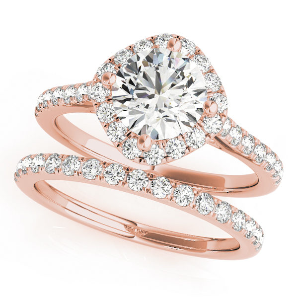 A wedding ring set made of rose gold, and consists of a halo style engagement ring with a diamond-shaped base, with an embellished band; and a diamond studded wedding band.