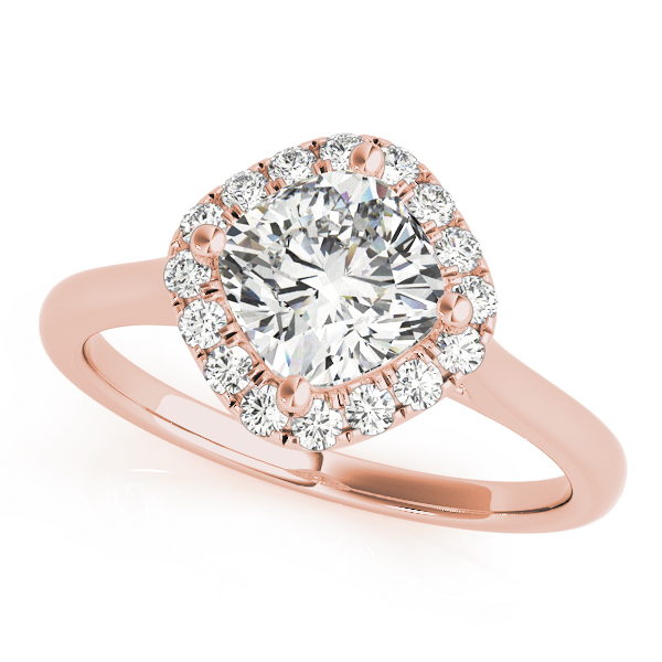An engagement ring with a diamond shaped centre piece, surrounded by a halo of smaller round shaped diamonds, all set in rose gold.