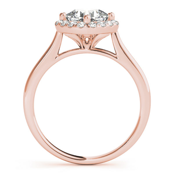 The side view of a halo style rose gold engagement ring with a flower style under gallery, and a plain band.