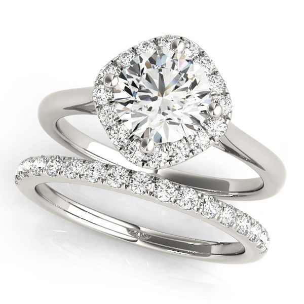 A wedding ring set made of white gold, which consists of a diamond shape base halo engagement ring, and a diamond embellished wedding band; set against a white background.