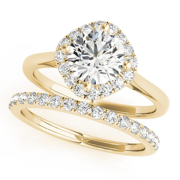 A wedding ring set made of yellow gold, which consists of a diamond shape base halo engagement ring, and a diamond embellished wedding band; set against a white background.