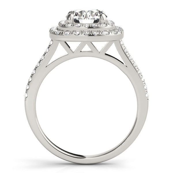 The side view of a white gold double halo engagement ring with a double V-shaped under gallery, seta against a white backdrop.